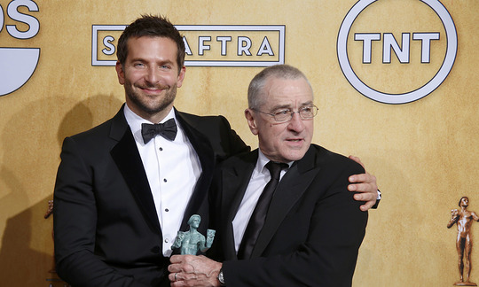 Actor-Bradley-Cooper-and-presenter-Robert-De-Niro-pose-for-photos-backstage-after-American-Hustle-won-for-Outstanding-Performance-by-a-Cast-in-a-Motion-Picture-at-the-20th-annual-Screen-Actors-Guild-A