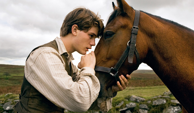 """""""WAR HORSE"""" DM-AC-00034 Albert (Jeremy Irvine) and his horse Joey are featured in this scene from DreamWorks Pictures' """"War Horse"""", director Steven Spielberg's epic adventure for audiences of all ages, and an unforgettable odyssey through courage, friendship, discovery and wonder. Ph: Andrew Cooper, SMPSP ©DreamWorks II Distribution Co., LLC. All Rights Reserved."""
