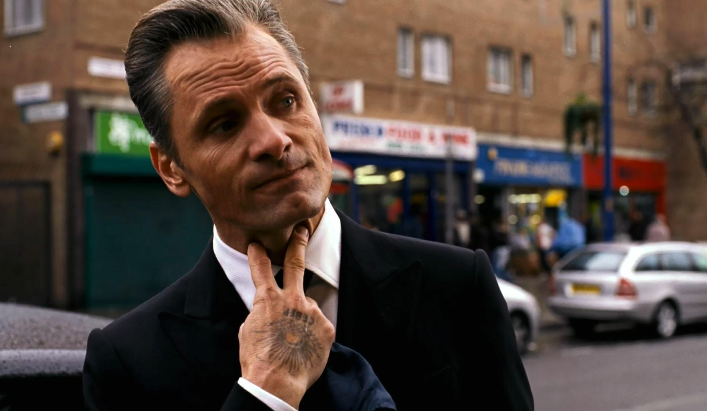 Here is Viggo Mortensen at his most menacing - covered in tattoos as a London mob boss. The actor plays the Eastern European leader of one of London's most notorious organized crime families in Eastern Promises. He soon butts heads with Anna, played by Naomi Watts, an innocent midwife who accidentally uncovers potential evidence against the crime family. The movie, reuniting Viggo with director David Cronenberg, also stars Vincent Cassel. Pictured: Viggo Mortensen Ref: SPL1134 Splash News and Pictures Los Angeles: 310-821-2666 New York: 212-619-2666 London: 870-934-2666 photodesk@splashnews.com Splash News and Picture Agency does not claim any Copyright or License in the attached material. Any downloading fees charged by Splash are for Splash's services only, and do not, nor are they intended to, convey to the user any Copyright or License in the material. By publishing this material , the user expressly agrees to indemnify and to hold Splash harmless from any claims, demands, or causes of action arising out of or connected in any way with user's publication of the material.