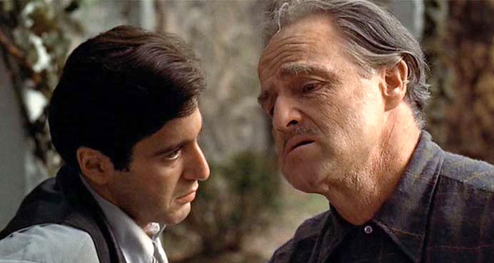Marlon Brando (Don Vito Corleone) instructs his youngest son Al Pacino (Michael Corleone).