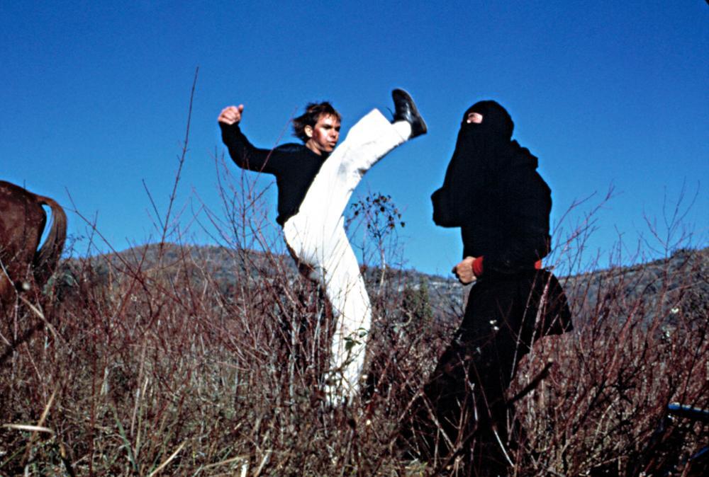 GYMKATA, Kurt Thomas, fighting a masked enemy, 1985.